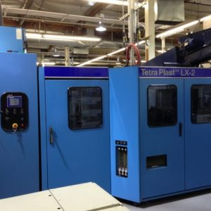 1999 Tetra Plast Model LX-2 (2) Cavity PET Re-Heat Stretch Blow Molding Machine